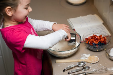 image of child in the kitchen, having fun prepping a recipe