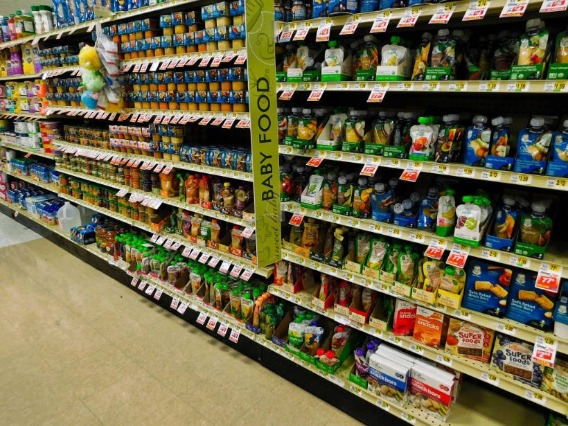 Image of grocery store aisle with shelves of baby food jars and pouches